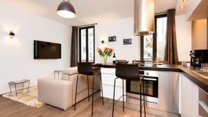 Cuisine et salon du 3 pièces place Gambetta